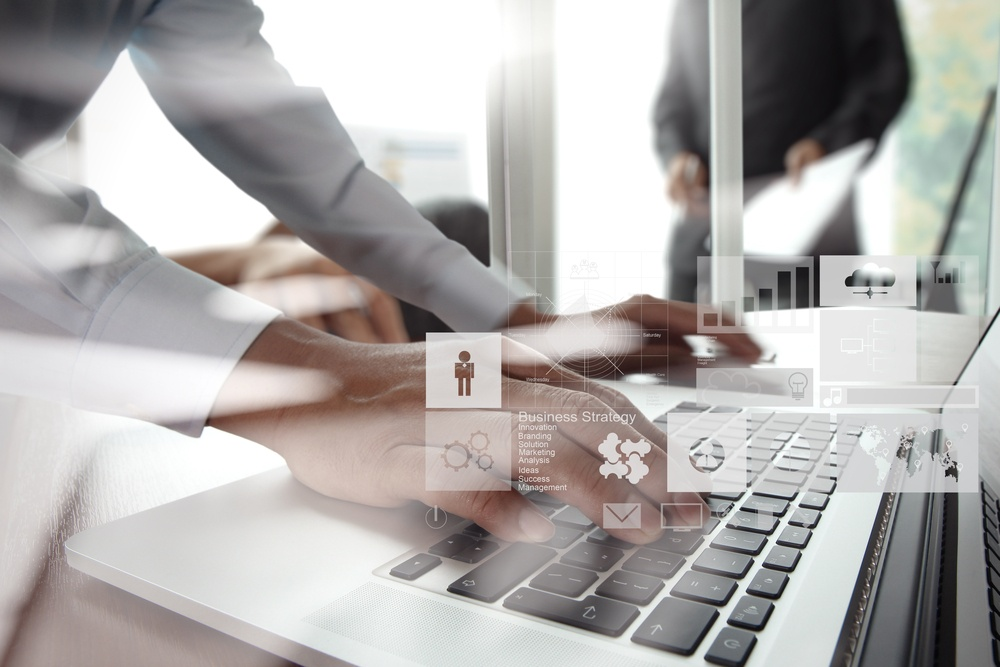 double exposure of new modern laptop computer with businessman hand working and business strategy as concept.jpeg